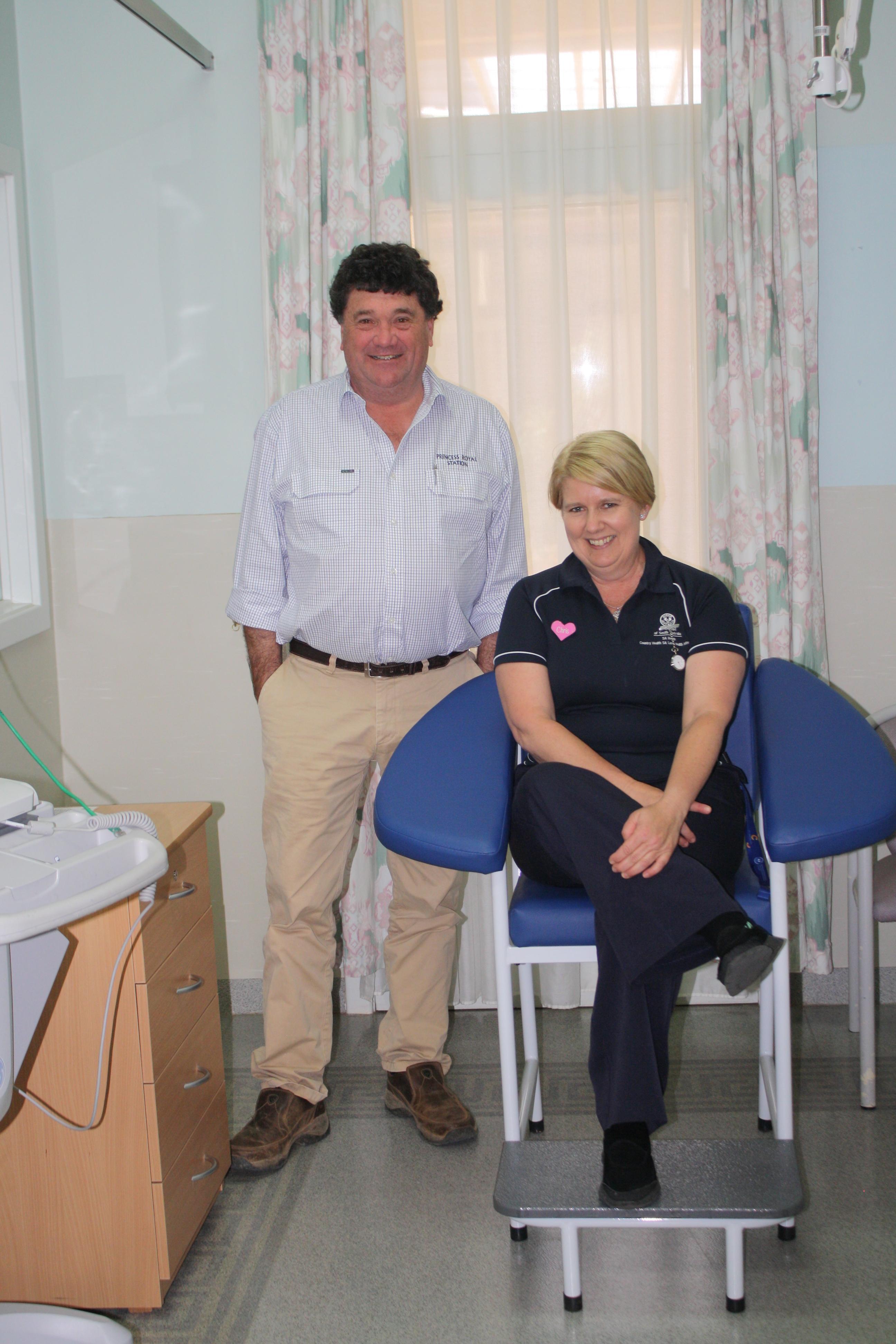 Princess Royal's Simon Rowe and Burra Hospital's Chris Landorf with the new blood collecting chair.
