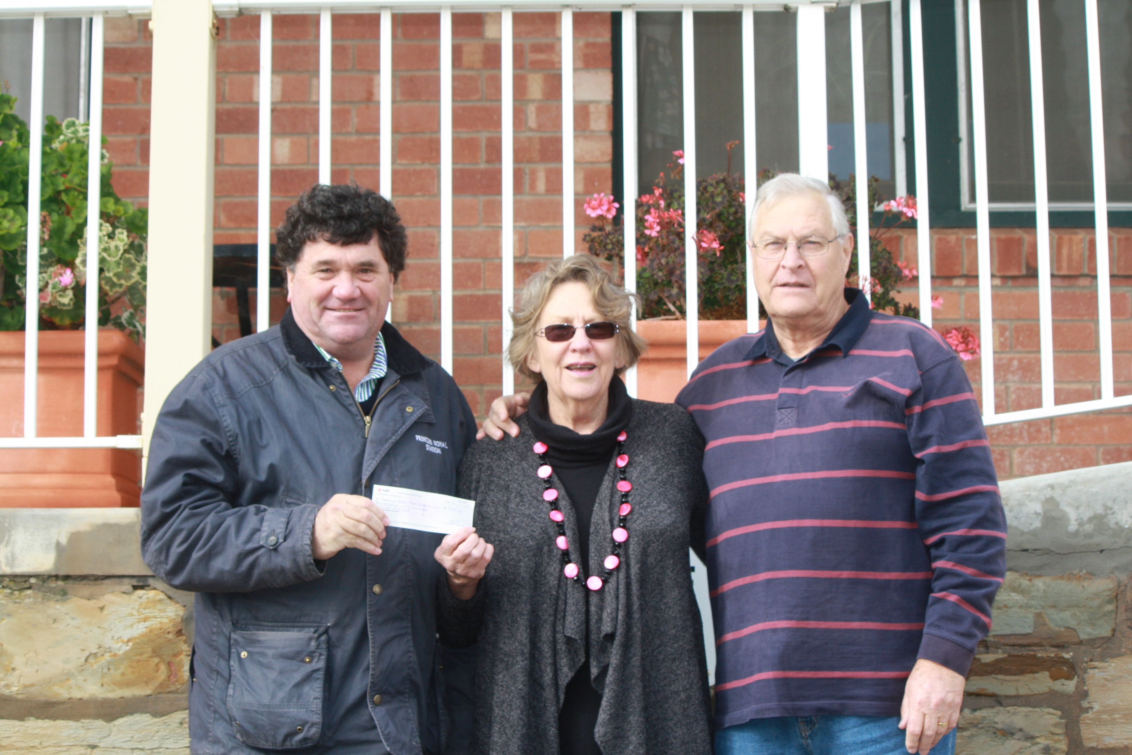 Princess Royal Station's Simon Rowe hands over the cheque to Meals on Wheels Burra chair Bev Fleming and treasurer Peter Ferris.